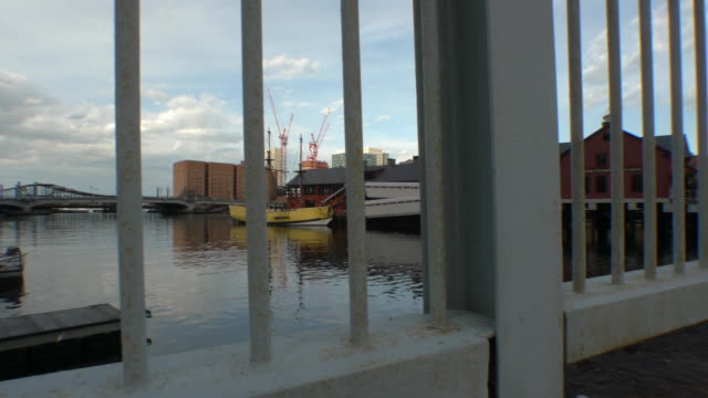 yellow replica ship the beaver behind railings - anchored stock videos & royalty-free footage