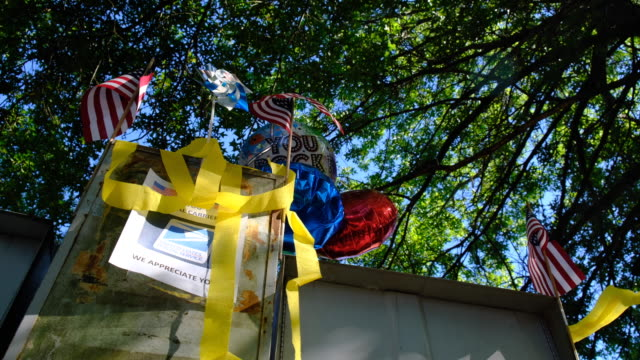 yellow ribbons on a mailbox. bloomington, indiana, united states - : a united states post office letterbox in the hyde park neighborhood of... - time of day stock videos & royalty-free footage
