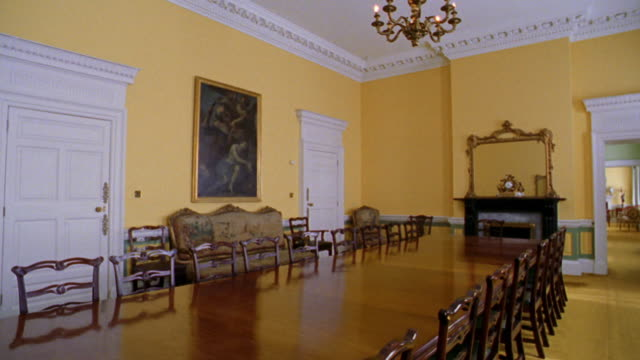 PAN yellow room with large wooden table in center in Dublin Castle / Dublin, Ireland