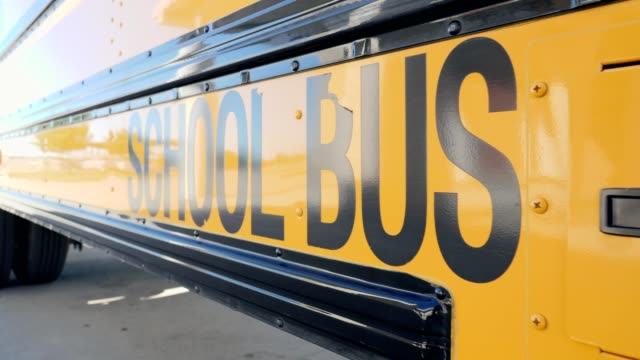 yellow school bus in parking lot - back to school stock videos & royalty-free footage