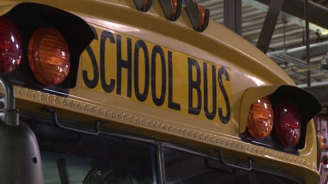 yellow school buses on august 17, 2012 in indianapolis, indiana - 分校点の映像素材/bロール