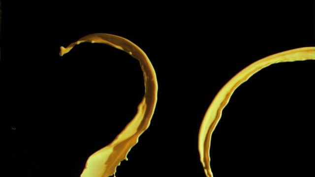 Yellow splashes in super slow motion rising