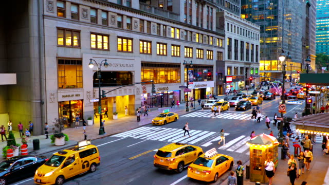 Yellow taxi and illumination 42nd street mid aerial view