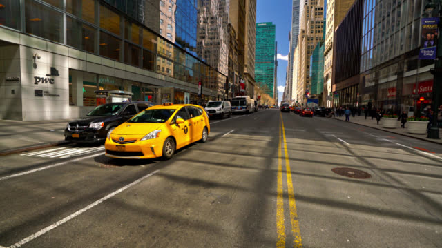 yellow taxi at new york street - yellow taxi stock videos & royalty-free footage