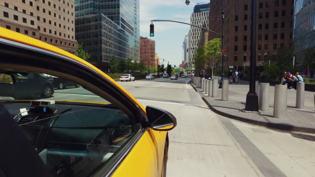Yellow taxi cab driving in New York POV