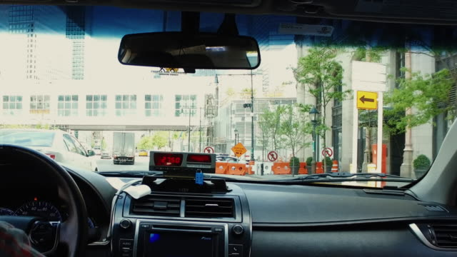 Yellow taxi driver driving in New York POV