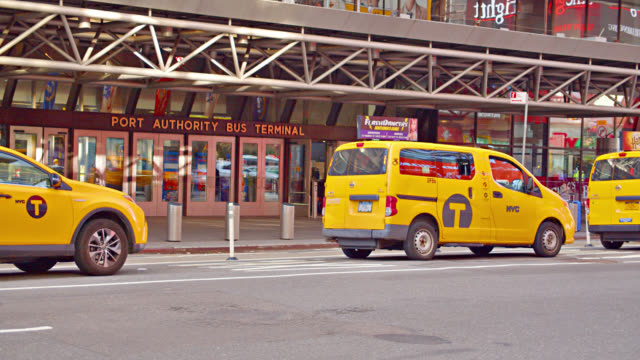 yellow taxi ride and wait for passengers at the entrance to port authority - entrance sign stock videos & royalty-free footage
