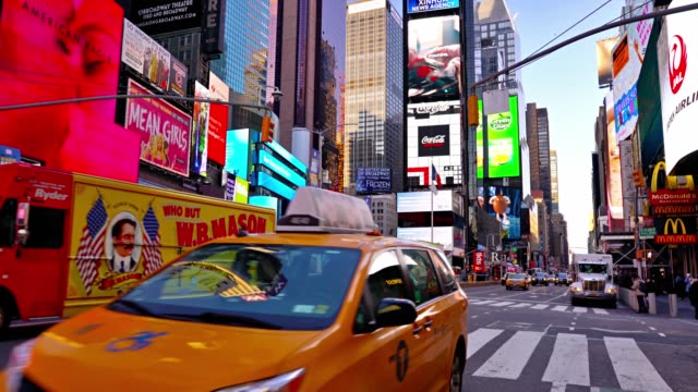yellow taxi. times square - yellow taxi video stock e b–roll
