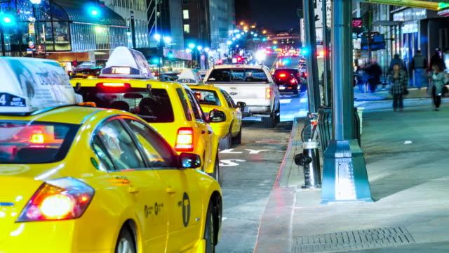 vídeos de stock, filmes e b-roll de yellow taxis and pedestrian traffic outside grand central terminal / park avenue, madison avenue, midtown manhattan, new york city, usa - yellow taxi