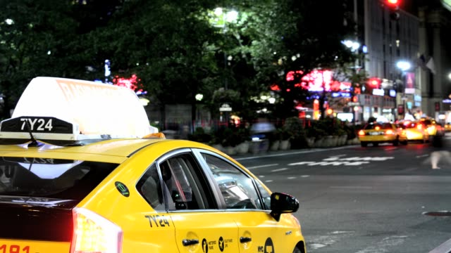 yellow taxis on broadway herald square 34th street midtown manhattan new york city usa - 34th street stock videos and b-roll footage