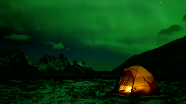 a yellow tent with aurora in tombstone territorial park yukon - tent stock videos and b-roll footage