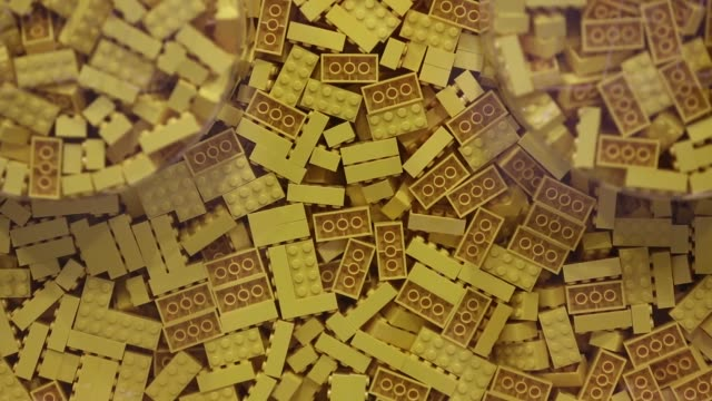 Yellow toy bricks sit in a container at the Lego A/S Factory in Kladno Czech Republic on Monday Nov 16 2015