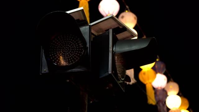 Yellow traffic light in the night