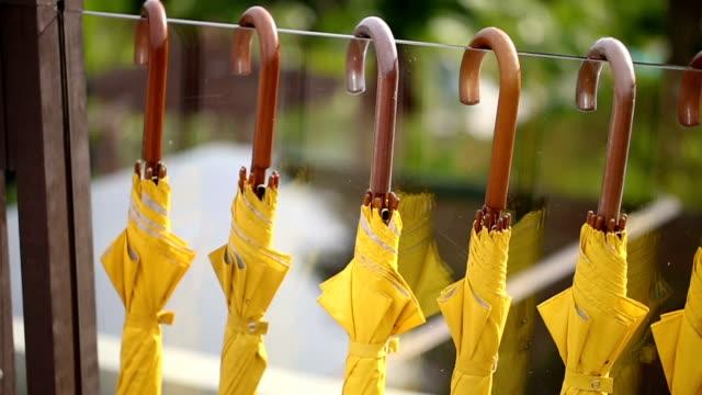 yellow umbrellas hanging. - ombrello video stock e b–roll