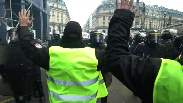 Yellow Vest protests continue amidst poor weather FRANCE Paris EXT Various of Yellow Vest protesters campaigning against fuel tax rises and the high...