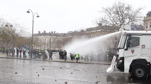 yellow vests and police and gendarmerie forces use of water cannon and Tear gas in front of the triumphal arch