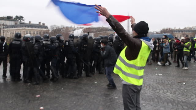 yellow vests and police and gendarmerie forces use tear gas - vest stock videos & royalty-free footage