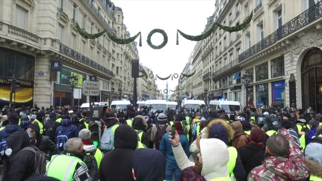 yellow vests place de l'opera in front of police forces and gendarmerie - place de l'opera stock videos and b-roll footage