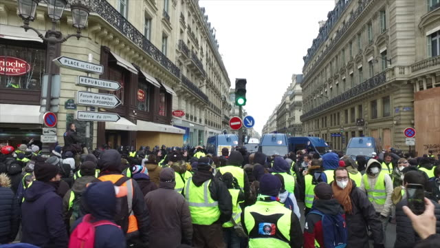 yellow vests place de l'opera in front of police forces and gendarmerie - vest stock videos & royalty-free footage
