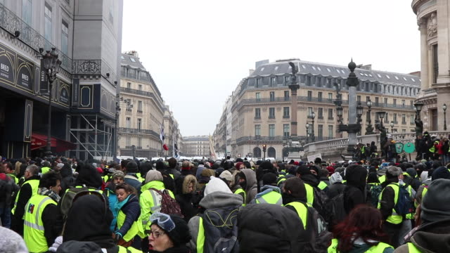 yellow vests with french flags place de l'opera garnier - place de l'opera stock videos and b-roll footage