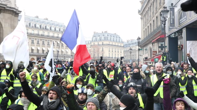 yellow vests with french flags place de l'opera garnier - vest stock videos & royalty-free footage
