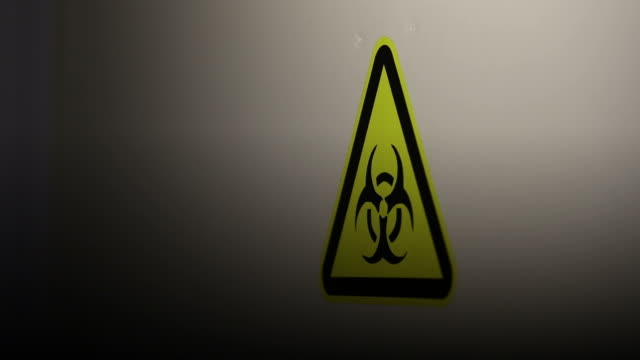 yellow warning sign with biohazard substances symbol - biohazard symbol stock videos & royalty-free footage