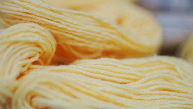 yellow yarn wool with natural dye for embroidery and knitting. - ball of wool stock videos & royalty-free footage