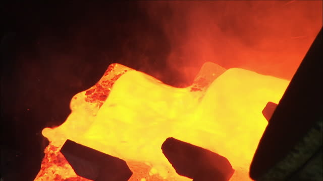 cu yellow-orange liquid gold pouring down from furnace, kalgoorlie, western australia, australia - melting stock videos & royalty-free footage
