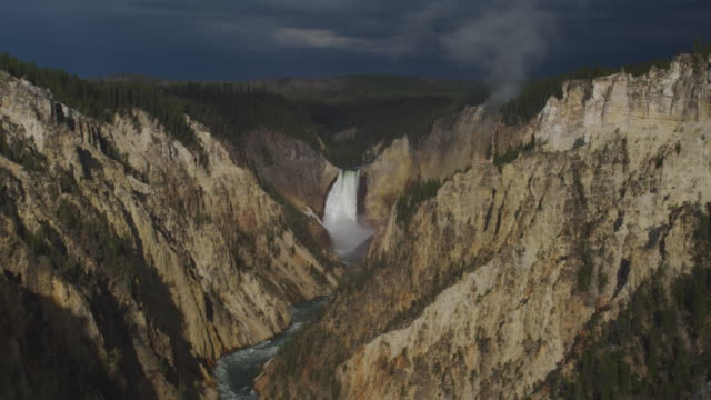 Yellowstone Falls plunges into a narrow canyon.