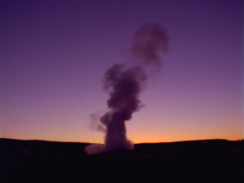 yellowstone: old faithful after sunset - old faithful stock videos & royalty-free footage