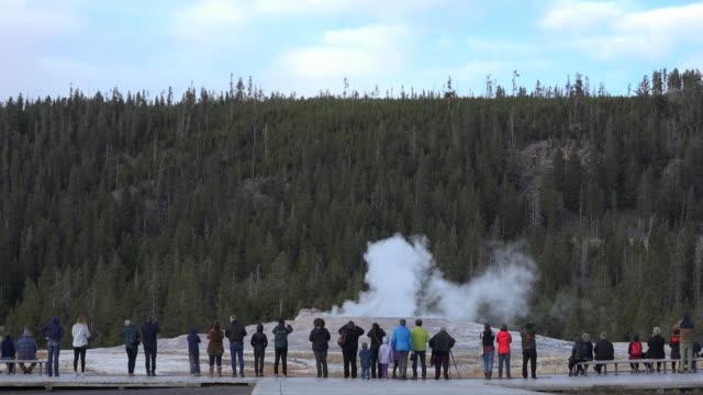 yellowstone old faithful eruption start with people watching - old faithful stock videos & royalty-free footage