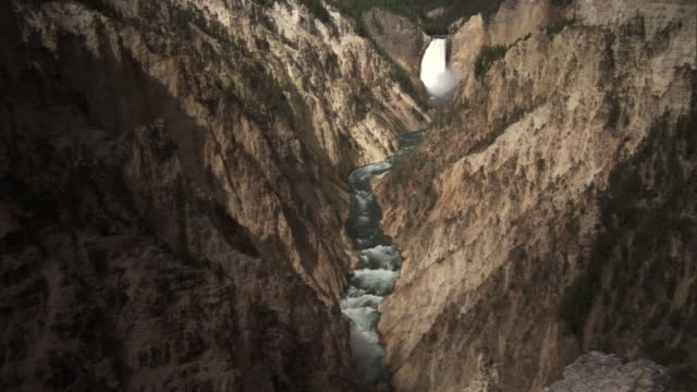 yellowstone river flows through gorge under the lower falls, yellowstone, usa - lower yellowstone falls stock videos & royalty-free footage