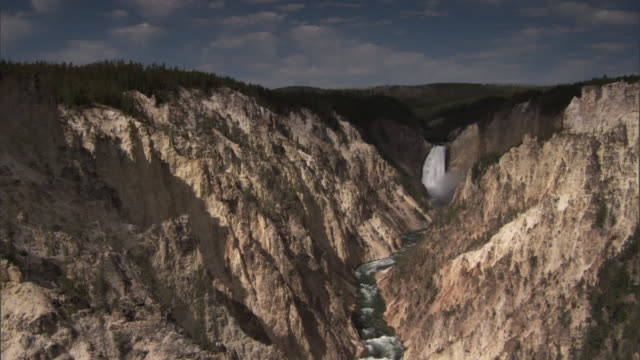 yellowstone river flows through gorge under the lower falls, yellowstone, usa - river yellowstone stock videos & royalty-free footage