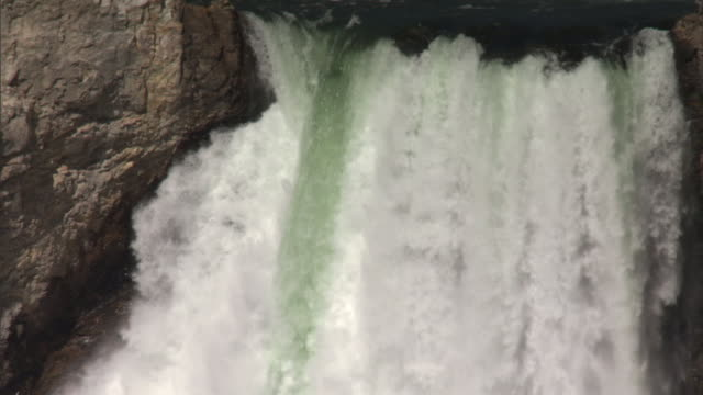 yellowstone river pours over crest of lower falls, yellowstone, usa - lower yellowstone falls stock videos & royalty-free footage