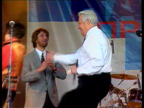 yeltsin health scare location unknown cms yeltsin dancing to music with pop group tx - pop music stock-videos und b-roll-filmmaterial