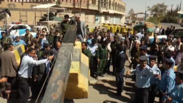 vídeos de stock, filmes e b-roll de yemen authorities remove the roadblock after the construction work outside the embassy of united states is suspended in capital sanaa yemen on march... - barricada divisa