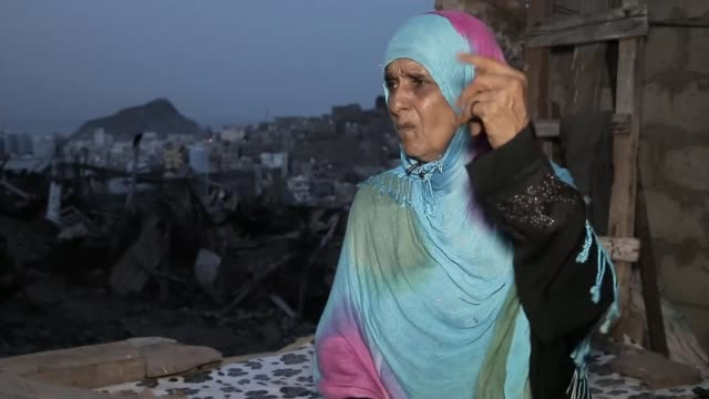 yemen struggles with coronavirus pandemic; yemen: aden: ext interview with woman whose husband has died from coronavirus cutaway int coronavirus... - yemen bildbanksvideor och videomaterial från bakom kulisserna
