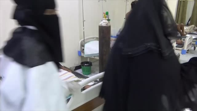 yemen struggles with coronavirus pandemic; yemen: aden: int various of coronavirus patients being lying in beds in busy hospital ward - yemen stock videos & royalty-free footage
