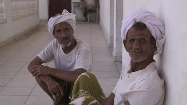 yemeni fishermen and their families from babelmandeb wait out the war at the al rahma orphanage turned refugee camp in obock djibouti - corno d'africa video stock e b–roll