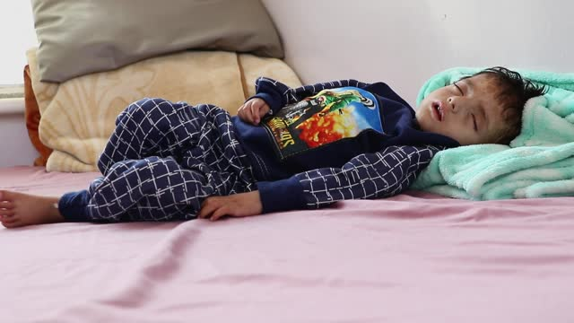 yemeni malnourished child is seen at a hospital where he receives treatment against malnutrition on april 03, 2021 in sana'a, yemen. yemen's six... - yemen stock videos & royalty-free footage