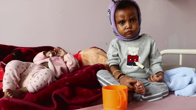 yemeni malnourished children are seen as they receive treatments at al-sabeen hospital's malnutrition treating department on may 06, 2021 in sana'a,... - hungry stock videos & royalty-free footage