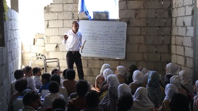 a yemeni man opens his house in the southern yemeni city of taez to school children of the war and offer education to students who no longer had... - yemen stock videos and b-roll footage