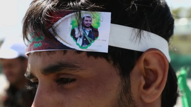 yemeni man wears a headband painted with a picture of the houthi leader abdul-malik al-houthi during the annual ceremony commemorating the birthday... - headband stock videos & royalty-free footage