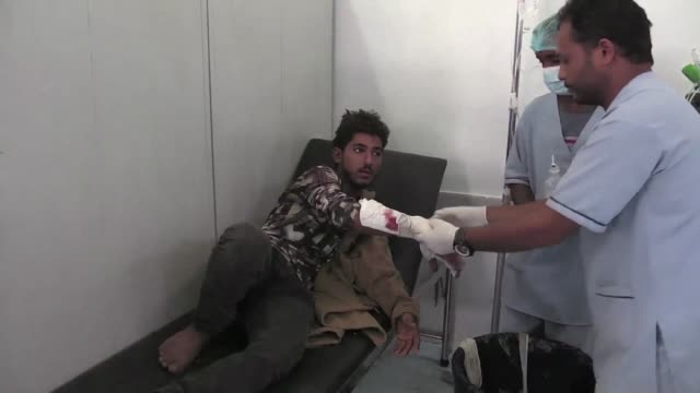 yemeni medics scrambled to save a 20 year old woman after a sniper's bullet tore a gash in her scalp in the port city of hodeida where a fragile... - war stock-videos und b-roll-filmmaterial