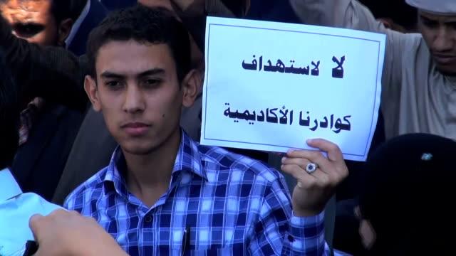 yemeni people protesting in sanaa and shouting slogans against the assassination of the yemeni opposition leader abdulmalik al mutawakkil - assassination stock videos and b-roll footage