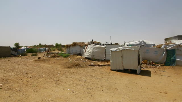 Yemeni refugees in a makeshift camp in northern Yemen