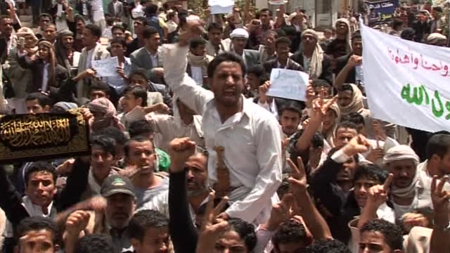 yemeni security forces fired warning shots, tear gas, and water cannon to disperse hundreds of protesters angry over an anti-islam film trying to... - water cannon stock videos & royalty-free footage
