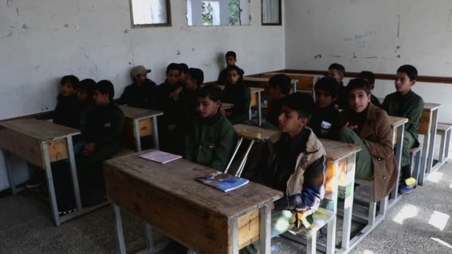 yemeni students attend the first day of their 2020-2021 education year on october 17, 2020 in sana'a, yemen. the united nations children's fund said... - prisoner education stock videos & royalty-free footage