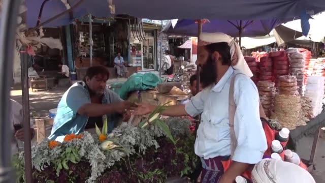 yemenis shop at a market in hodeida two days after yemeni rebels started to withdraw from the city's port under a truce agreement amid doubts over... - yemen stock videos & royalty-free footage