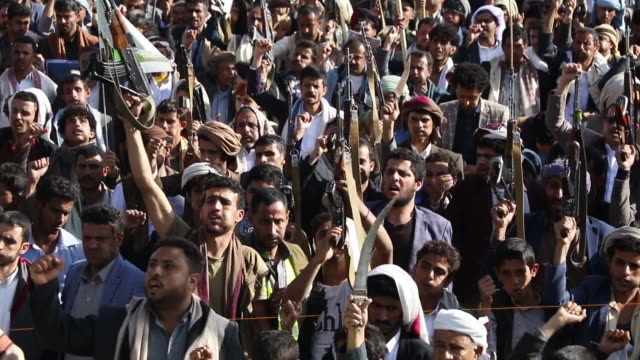 yemen's houthi supporters rally against the ongoing war and blockade on october 04, 2019 in sana'a, yemen. - yemen stock videos & royalty-free footage